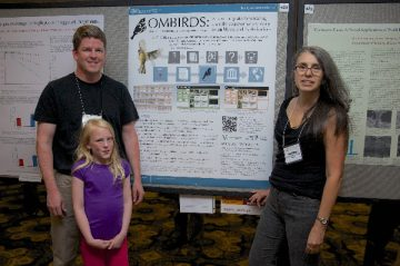 Maja Irwin helps her father Darren Irwin (Curator of Tetrapods) and Ildiko Szabo (Assistant Curator of Tetrapods) at the AOU poster session in Chicago. Photo taken by Arlene Koziol.