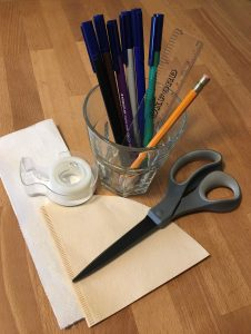 Supplies for the experiment along: coffee filter, paper towel, scissors, cup, markers, pencil, ruler, tape, water.