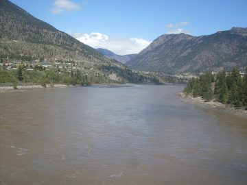 A wide view of the Fraser River flowing through Lillooet.